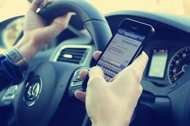 华盛顿州对开车打手机实行罚款_图1-2