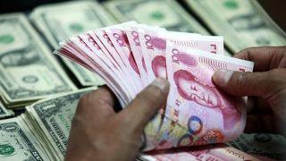 中国央行信心喊话提振市场 人民币即期汇率开盘一度收复6.90