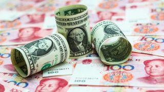 美联储释放降息信号 人民币对美元中间价大涨逼近6.88