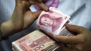 人民币破7第二天:即期汇率收涨,离岸汇率盘中涨超700点