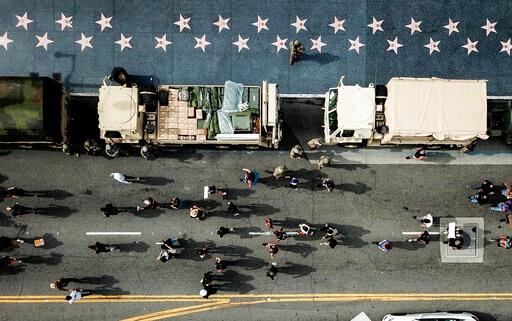 骚乱降温?和平示威者仍违宵禁表诉求 但破坏抢劫大减(多图)