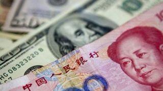 人民币汇率在岸、离岸市场分别跌破7.11和7.14